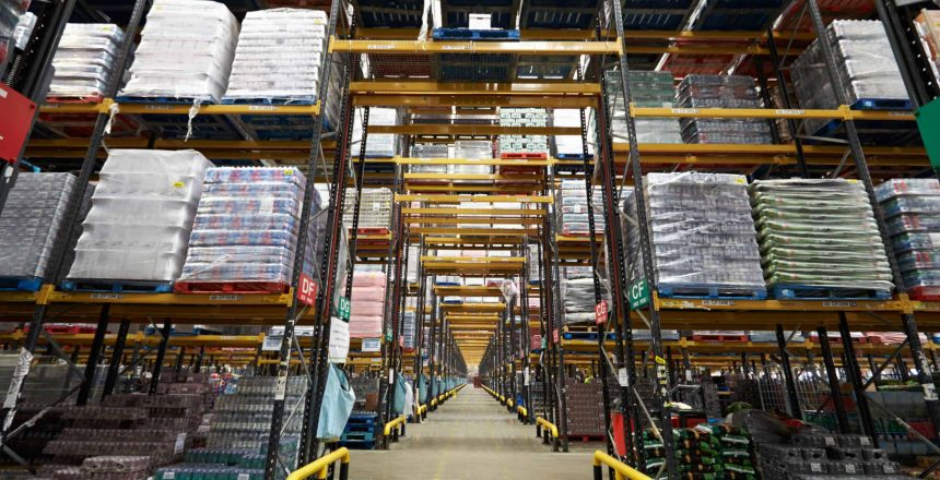 Long aisle between storage racks in a distribution warehouse